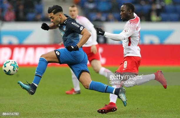 Hoffenheim's German midfielder Nadiem Amiri and Leipzig's Leipzig's Guinean midfielder Naby Keita vie for the ball during the German First division...
