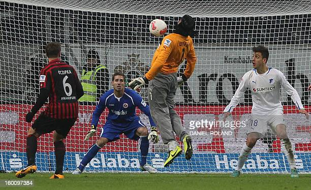 Hoffenheim's goalkeeper Tim Wiese tries to bring the ball inside Frankfurt's penalty area during the German first division Bundesliga football match...