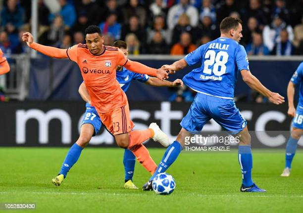 Hoffenheim's Hungarian forward Adam Szalai and Lyon's Dutch defender Kenny Tete vie for the ball during the UEFA Champions League Group F football...