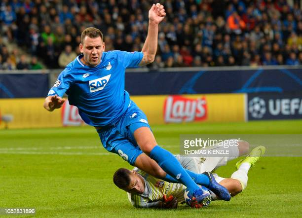 Hoffenheim's Hungarian forward Adam Szalai and Lyon's Portuguese goalkeeper Anthony Lopes vie for the ball during the UEFA Champions League Group F...
