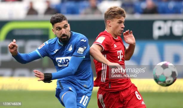 Hoffenheim's Israeli forward Munas Dabbur and Bayern Munich's German midfielder Joshua Kimmich vie for the ball during the German first division...