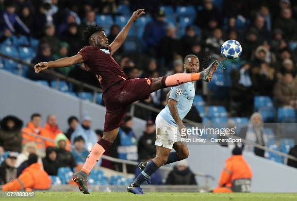Hoffenheim's Kasim Adams stretches for a high ball under pressure from Manchester City's Raheem Sterling during the UEFA Champions League Group F...