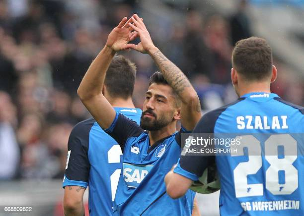 Hoffenheim's midfielder Kerem Demirbay celebrates scoring the 32 during the German First division Bundesliga football match between TSG Hoffenheim...