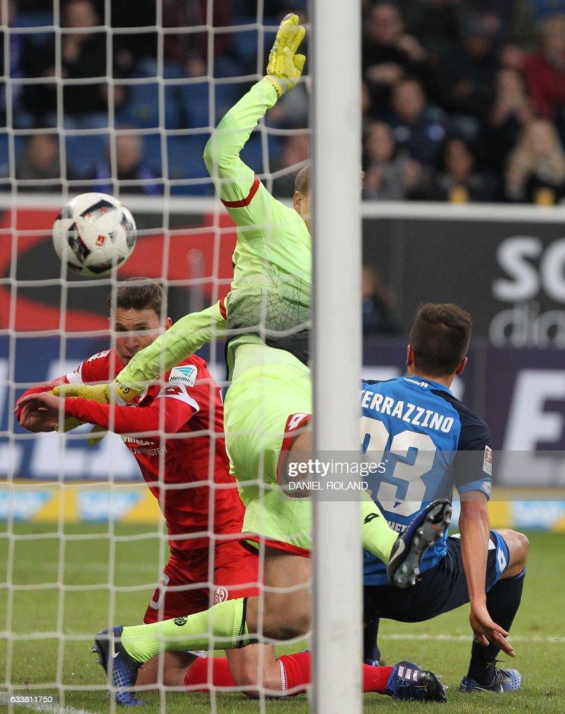 Hoffenheim's midfielder Marco Terrazzino scores during the German first division Bundesliga football match TSG 1899 Hoffenheim vs FSV Mainz 05 in Sinsheim, southern Germany, on February 4, 2017. / AFP PHOTO / Daniel