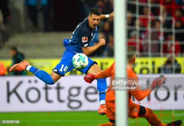 Hoffenheim's midfielder Sandro Wagner and Cologne's goalkeeper Timo Horn vie for the ball during the German First division Bundesliga football match...
