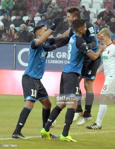 Hoffenheim's Nadiem Amiri Andrej Kramaric and Kerem Demirbay celebrate the 02 goal during the German Bundesliga soccer match between FC Augsburg and...