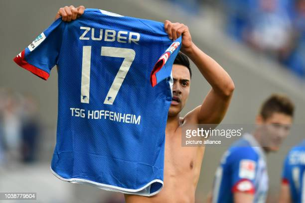 Hoffenheim's Nadiem Amiri celebrating his 21 goal with the jersey of Steven Zuber who could not play due to an injury during the German Bundesliga...