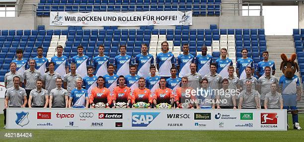 Hoffenheim's players and their mascot 'Hoffi' pose for a team picture during the team presentation of German first division Bundesliga football club...