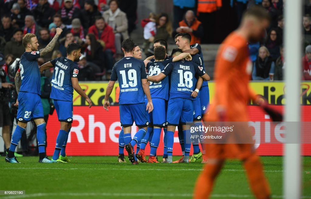Hoffenheim's players celebrate after Hoffenheim's German forward Sandro Wagner (R) scored the 0-2 during the German first division Bundesliga football match FC Cologne vs 1899 Hoffenheim in Cologne, western Germany, on November 5, 2017. /