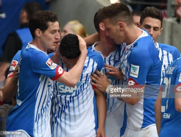 Hoffenheim's players celebrate Nadiem Amiri's 10 goal during the German Bundesliga soccer match between Eintracht Frankfurt and 1899 Hoffenheim in...