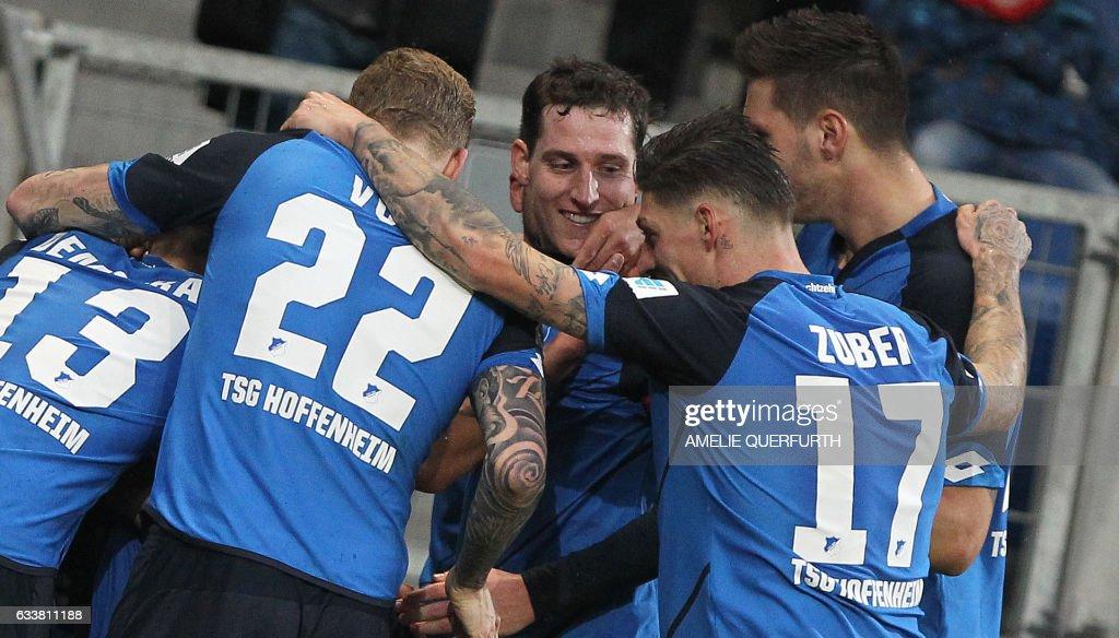 Hoffenheim's players celebrate scoring during the German first division Bundesliga football match TSG 1899 Hoffenheim vs FSV Mainz 05 in Sinsheim, southern Germany, on February 4, 2017. / AFP / Amelie QUERFURTH