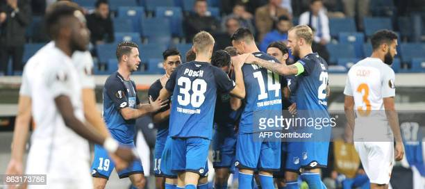 Hoffenheim's players celebrate scoring the opening goal with his teammates during the UEFA Europa League group C fotball match TSG 1899 Hoffenheim v...