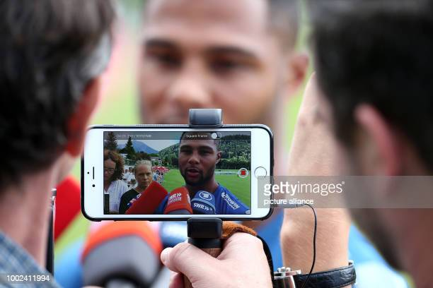 Hoffenheim's Serge Gnabry gives an interview for reporters at the training camp of German Bundesliga soccer team TSG 1899 Hoffenheim in...