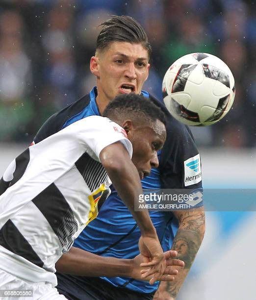 Hoffenheim's Swiss midfielder Steven Zuber and Moenchengladbach's Spanish defender Alvaro Dominguez vie for the ball during the German First division...