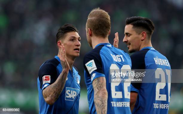 Hoffenheim's Swiss midfielder Steven Zuber celebrates after scoring his team's opening goal with Hoffenheim's midfielder Kevin Vogt and Hoffenheim's...