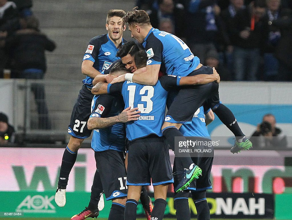 Hoffenheim's Swiss midfielder Steven Zuber (2nd L) celebrates scoring the 2-1 goal with his teammates during the German first division Bundesliga football match between TSG Hoffenheim and Hamburg SV in Sinsheim, southern Germany, on November 20, 2016. / AFP / DANIEL