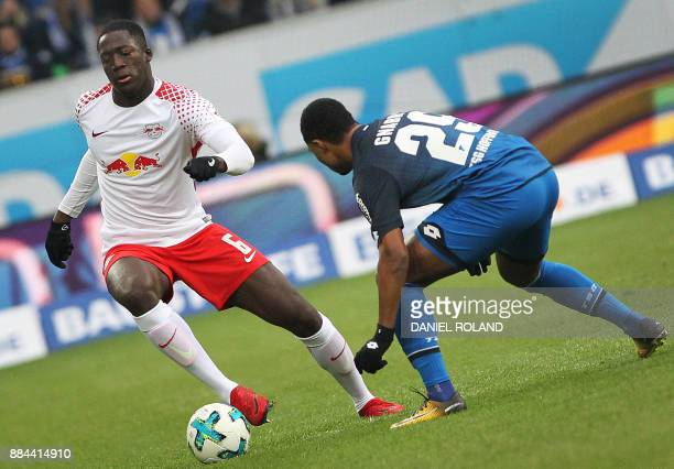 Hoffenheims's German midfielder Serge Gnabry and Leipzig's French defender Ibrahima Konate vie for the ball during the German First division...