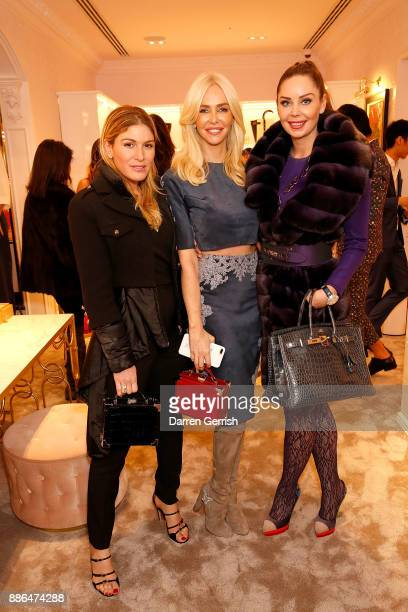 Hofit Golan Amanda Caroline Cronin and Nina Naustal attend the new flagship store launch of Aspinal on Regent's Street St James's on December 5 2017...