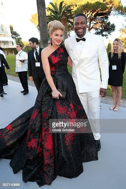 Hofit Golan and actor Chris Tucker attend the amfAR's 23rd Cinema Against AIDS Gala at Hotel du CapEdenRoc on May 19 2016 in Cap d'Antibes France