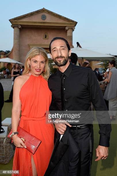 Hofit Golan and Adrian Brody pose as they attend attends the cocktail reception during The Leonardo DiCaprio Foundation 2nd Annual SaintTropez Gala...
