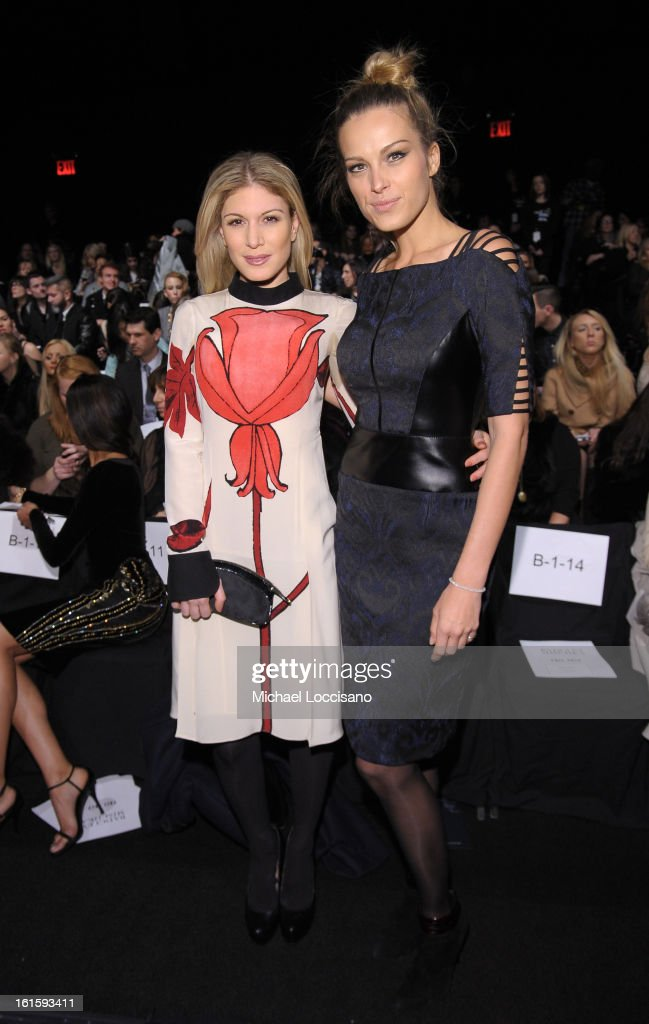 Hofit Golan and Petra Nemcova attend the Badgley Mischka Fall 2013 fashion show during Mercedes-Benz Fashion Week at The Theatre at Lincoln Center on February 12, 2013 in New York City.