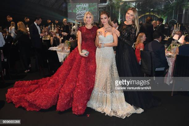 Hofit Golan and Victoria Bonya and Tetyana Veryovkina attend the amfAR Gala Cannes 2018 dinner at Hotel du CapEdenRoc on May 17 2018 in Cap d'Antibes...