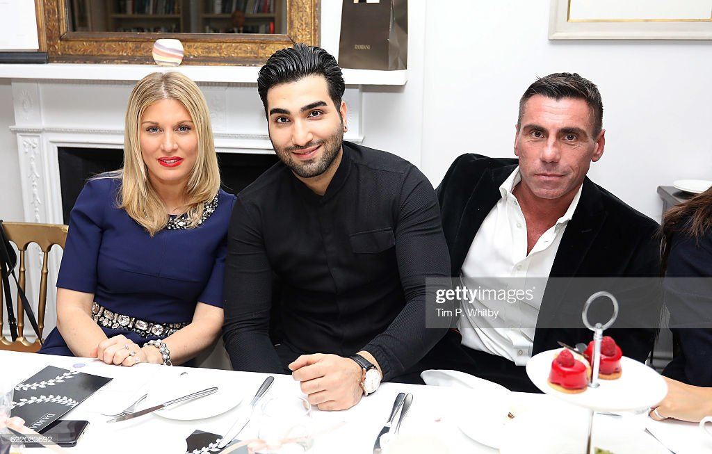 Hofit Golan, Hossein Tohi and Alessandro Grassini-Grimaldi attend an afternoon tea hosted by Damiani in aid of Nadedza Foundation at Morton's Club on November 9, 2016 in London, England.