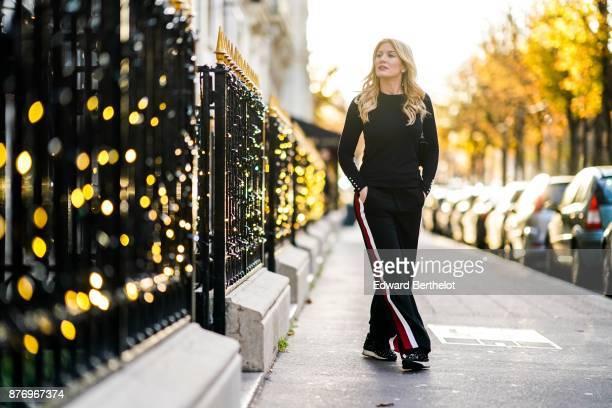 Hofit Golan model and TV host wears Zara sportswear pants with printed stripes a Zara black top a Gucci bag a Gucci black fur coat Casadei shoes at...