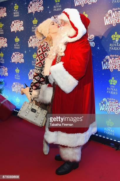 Hofit Golan poses with Father Christmas at the Winter Wonderland VIP launch night at Hyde Park on November 16 2017 in London England
