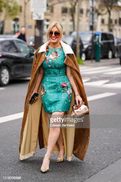 Hofit Golan wears sunglasses a brown long coat a green dress with floral embroidery a bronze color shiny bag golden pointy shoes outside Leonard...