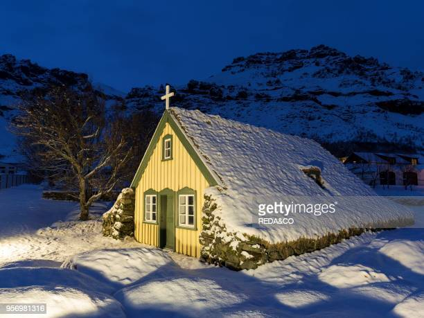 Hofskirkja the historic church of village Hof near Vatnajoekull NP during winter The church is listed and an example of a traditional church with a...