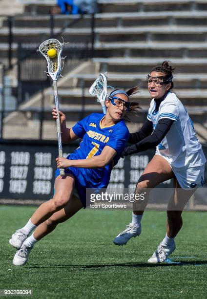 Hofstra Alyssa Parrella cuts around Johns Hopkins Shannon Fitzgerald during a women's college Lacrosse game between the Johns Hopkins Blue Jays and...