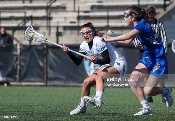 Hofstra Alyssa Parrella defends against Johns Hopkins Nicole DeMase during a women's college Lacrosse game between the Johns Hopkins Blue Jays and...