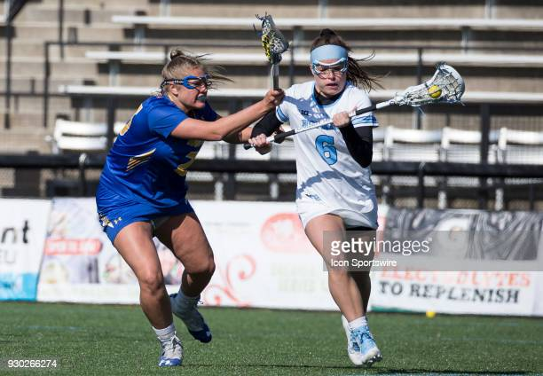 Hofstra Darcie Smith checks Johns Hopkins Maggie Schneidereith during a women's college Lacrosse game between the Johns Hopkins Blue Jays and the...