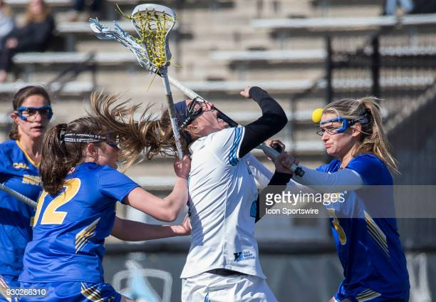Hofstra Drew Shapiro checks into Johns Hopkins Nicole DeMase during a women's college Lacrosse game between the Johns Hopkins Blue Jays and the...