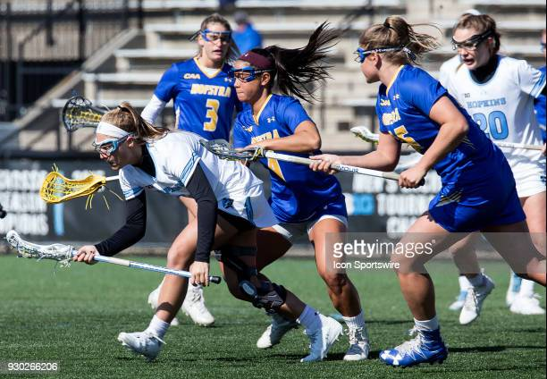 Hofstra Elena Schorr checks into Johns Hopkins Aurora Cordingley during a women's college Lacrosse game between the Johns Hopkins Blue Jays and the...