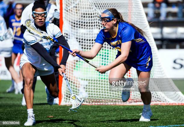 Hofstra Katie Whelan defends against Johns Hopkins Trinity McPherson during a women's college Lacrosse game between the Johns Hopkins Blue Jays and...