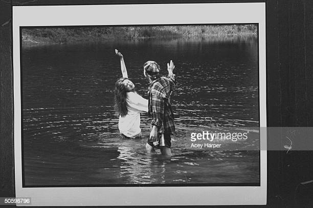 Hofstra Univ students Rennie Gross Eric Bloomstein frolicking in a lake at a tourist attraction they are members of Douglas Brinkley's An Amer...