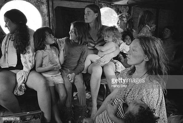Hog Farm members ride in a bus to the free Woodstock Music and Art Fair About 450000 people attended the three day concert which turned into chaos...
