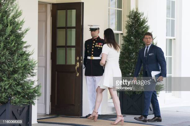 Hogan Gidley White House deputy press secretary right enters the White House after speaking with members of the media in Washington DC US on Tuesday...
