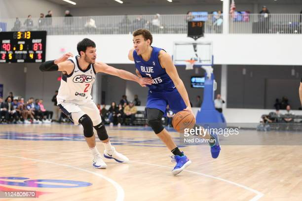 J Hogg of the Delaware Blue Coats drives against Duje Dukan of the Capital City GoGo during an NBA GLeague game at the 76ers Fieldhouse on February 3...