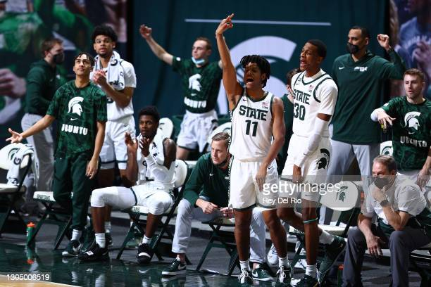 Hoggard and the Michigan State Spartans celebrates in the second half of the game against the Indiana Hoosiers at Breslin Center on March 02, 2021 in...