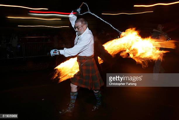 Hogmanay fireball swingers illuminate the streets of Stonehaven carrying on the tradition of welcoming the new year January 1 Stonehaven Scotland...
