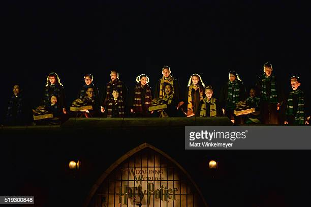 Hogwarts choir performs onstage at the opening of the Universal Studios' 'Wizarding World of Harry Potter Opening' at Universal Studios Hollywood on...