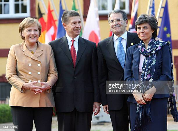 Italian Prime Minister Romano Prodi and his wife Flavia Franzoni pose with German Chancellor Angela Merkel and her husband Joachim Sauer upon their...