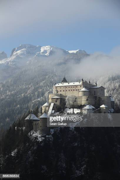 Hohenwerfen Castle stands on a crisp winter morning under a mountain of the Berchtesgaden Alps among trees brushed with snow on December 7 2017 near...
