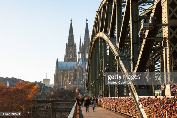 hohenzollern bridge and cathedral, cologne, germany - cologne stock pictures, royalty-free photos & images