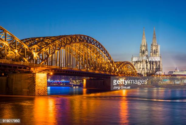 hohenzollern bridge and cologne cathedral at dusk - cologne stock pictures, royalty-free photos & images