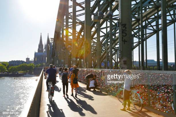 hohenzollern bridge in late afternoon sun, cologne, germany - north rhine westphalia stock pictures, royalty-free photos & images