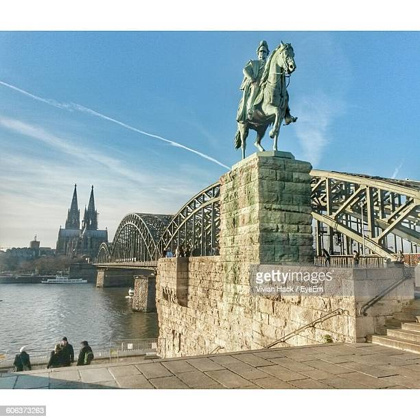 hohenzollern bridge over rhine river in city against sky - cologne stock pictures, royalty-free photos & images